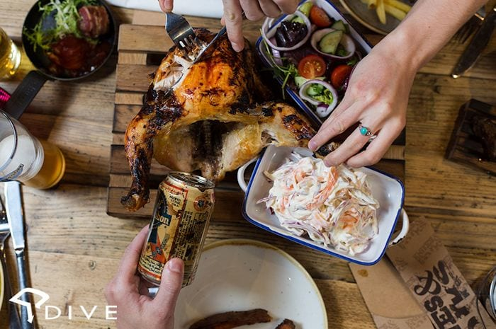 VIDEO | Dive NQ launch new alt Sunday brunch 'beer can chicken' and it's clucking great! I Love Manchester