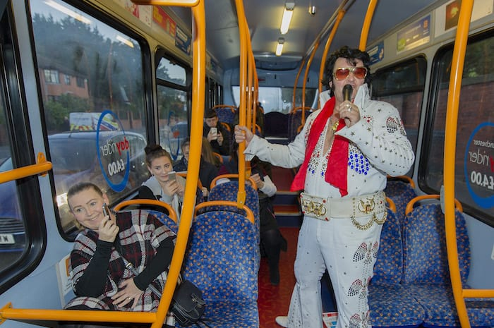 Photograph by Peter Powell. 11-10-2016 A Elvis Presley impersonator tries the Stagecoach Route 56 into Manchester.