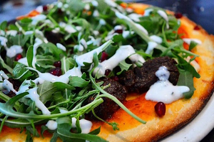 Dough Pizza Kitchen has a spruce up and reopens with new creative pizzas including Surf & Turf