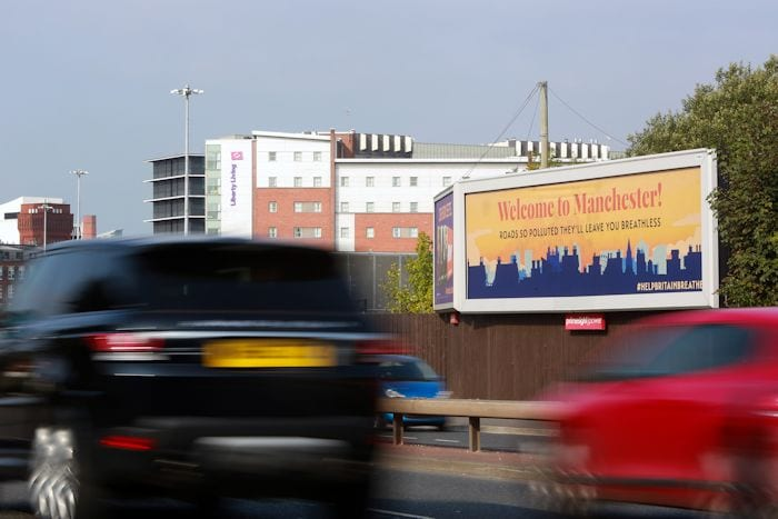 Billboard on one of Manchester's busiest roads warns motorists of invisible killer I Love Manchester