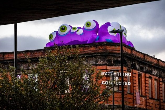Beware! Giant monsters have taken over the rooftops and shops of Manchester I Love Manchester