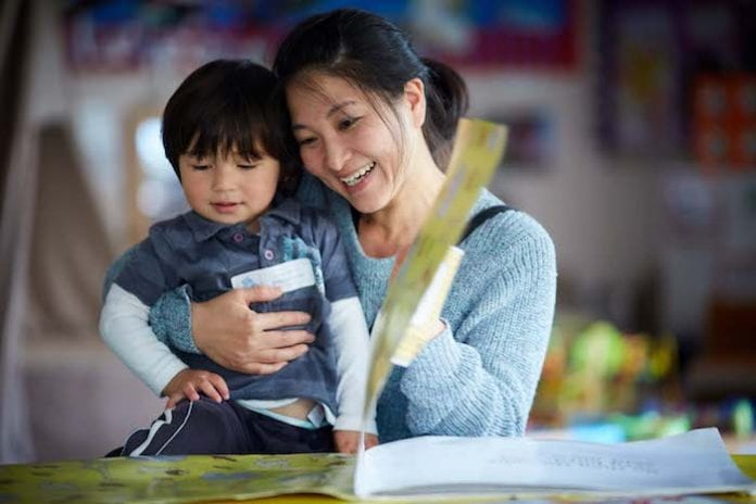 Mother Kimie Knowles and her son Kai aged 2 at Martenscroft (cor) Nursery School and Children's centre in Hulme, Manchester.