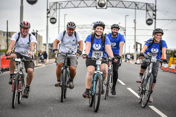 Cycle for a good cause this summer with Manchester to Blackpool and Manchester 100 charity bike rides I Love Manchester